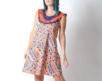 Orange and blue dress, Flared floral dress, Floral patterned supple dress, Orange and blue tent dress FR38 / UK 10.