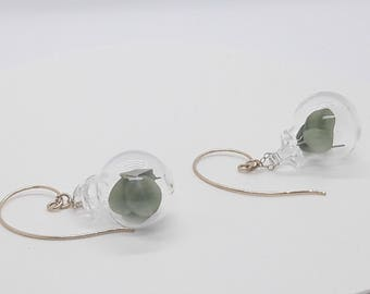 Clear glass bubble statement earrings with eucalyptus plants inside