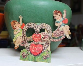 Valentine Mechanical Die Cut Germany Lithograph Girls on a Seesaw with Violets VINTAGE by Plantdreaming