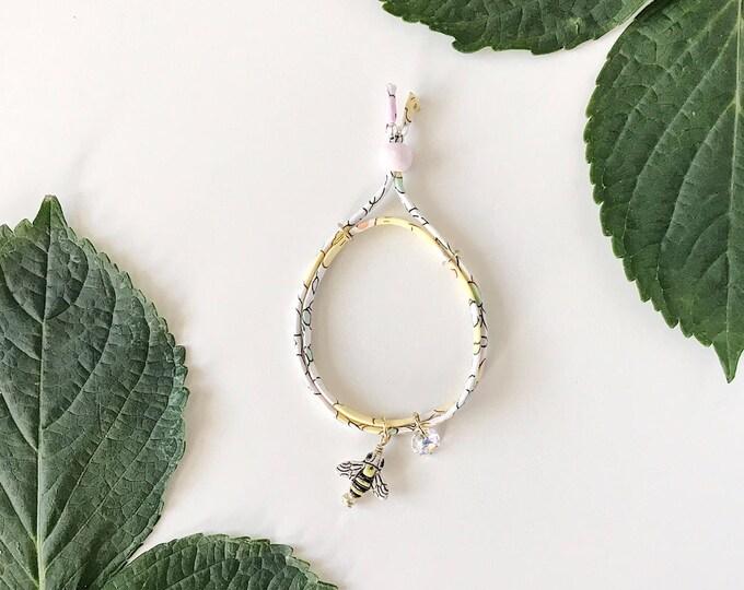 Featured listing image: Liberty of London Charm Bracelet for Little Girls, Adjustable Size, Bumblebee Charm, giddyupandgrow