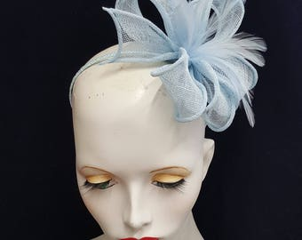 Pale blue baby blue powder blue sinamay and feather fascinator on headband fixing ideal weddings races