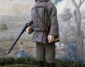 Porcelain dollhouse Edwardian gentleman dressed in tweed