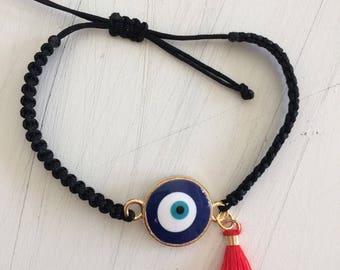eye bracelet with tiny tassel