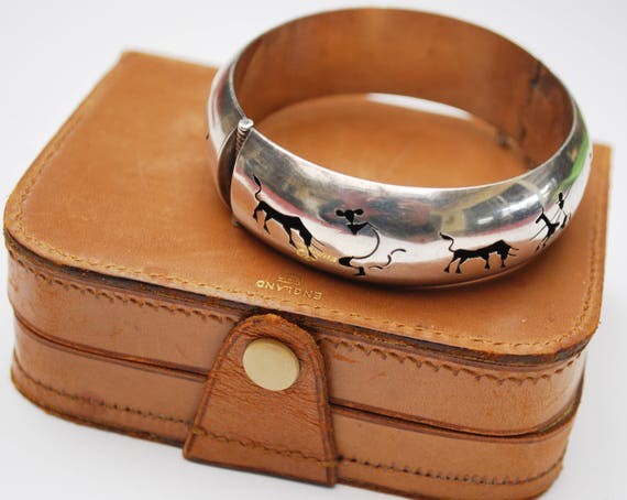 Sterling Hinged Bangle - Signed Mexico JCB - Shadow box - Silver Hollow cut outs -  buffalo - Tribal southwestern bracelet
