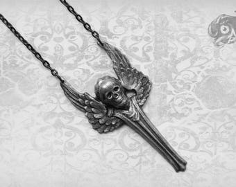 Gothic winged Archangel necklace with skull face in silver // Hand-painted brass with patina and gunmetal tone chain // Macabre Goth jewelry