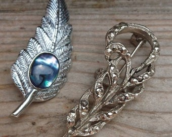 Vintage feather and a leaf brooch
