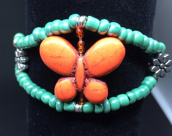 Orange butterfly with green beads