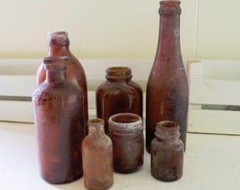 Lot of 7 Antique Old Bottles Amber Colored Lysol and misc bottles