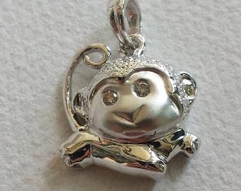 14 k white gold monkey diamond pendant