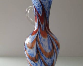 E.g Florence Vase, in the colours blue, orange, red and white.