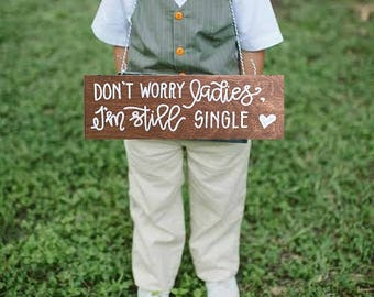 i'm still single sign / don't worry ladies / daddy here comes mommy sign / wedding sign / ring bearer sign / aisle sign.