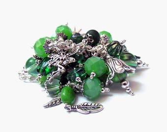 Green forest cluster bracelet, Woodland charm bracelet with green lampwork beads Shaggy bead soup bracelet silver animal charms boho artisan