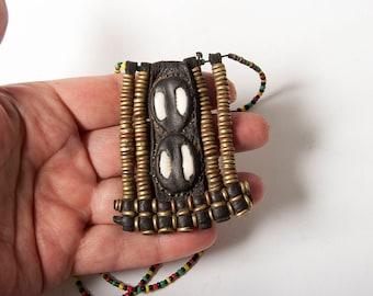 Wodaabe or Fulani leather and shell pendant
