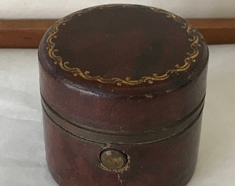 Small inkpot covered in leather