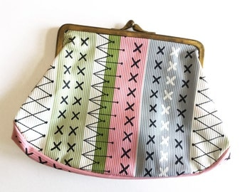 Cosmetics purse, makeup bag with clasp and mid century atomic patterns