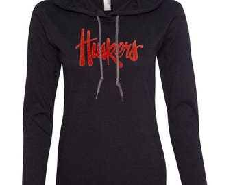 Women's Nebraska Legacy Script Glitter Huskers Long Sleeve Hooded Tee Shirt Hoody With Relaxed Unlined Hood With Contrasting Drawcord