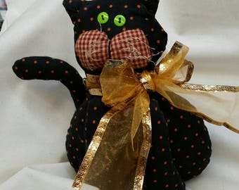 Black Kitty with Orange Dots