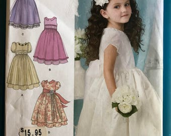 Simplicity 1507 - Girl's Special Occasion Dress with Sleeveless or Short Sleeve Option and Flared Skirt with Sheer Overskirt - Sz 4 5 6 7 8