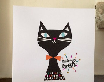 Handmade upcycled card with the image of a cat on the front. Suitable for any occassion. Approximately 17x17cm in size. Blank inside.