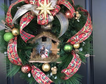 Christmas Nativity Scene wreath.  Joseph, Mary and baby Jesus.