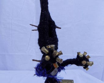 Dark gothic taxidermy sculpture with preserved wasps, claws, and rusted shell casings