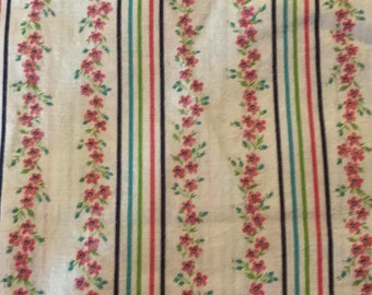 Multi-colored floral and stripes vintage feed sack fabric