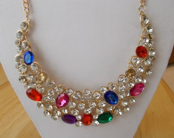 Bib Necklace with Clear and Multi Color Crystal Beads on a Gold Tone Chain
