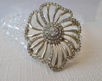 2 Row Clear Crystal Bead Stretch Cuff Bracelet with a Silver Tone and Clear Rhinestone Medallion