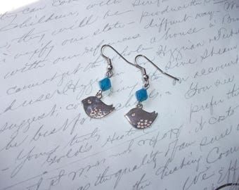 Silver bird charm earrings with aquamarine crystal