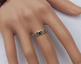 Sterling Silver Vintage Ring with a fine cut Black Onyx gem.      Unique design.