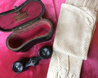 An antique pair of Opera Glasses in original leather case.