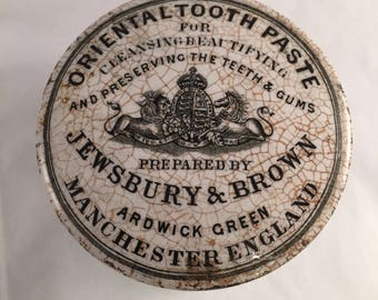 An antique toothpaste pot