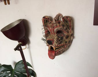 Antique dance mask. White tiger with plastic whiskers.