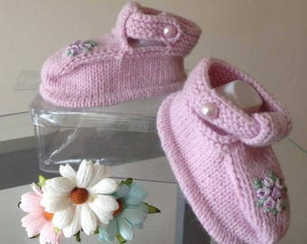 Beautiful hand knitted baby sandal with embroidered flower.