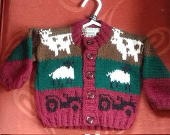 Hand knitted cardigan to fit a child aged 3-6 months