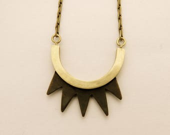 Long blackened brass spikes