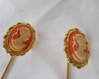 A pair of vintage cameo stick pins.