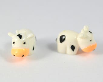 X 9 polymer clay miniature cow