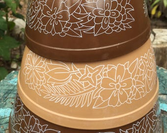 Set of three Pyrex bowls mixing bowls serving bowls 2 brown and 1 tan each with white flowers Woodland pattern 1978-1983