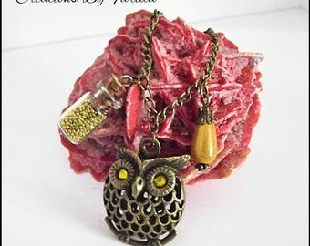 Pretty necklace with an OWL, a vial with yellow beads and a Pearl drop