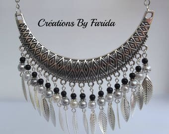 Bib necklace with grey and white beads and silver leaves