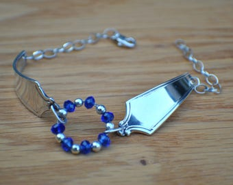 Sterling silver spoon handle bracelet, antique SS spoon handles turned into bracelet, dark blue crystals as center, chain and lobster claw