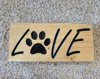 Carved LOVE signs with a paw print, Paw