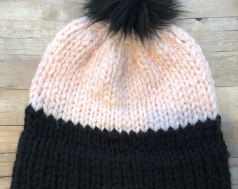 Pink and black double brimmed beanie with faux fur pom pom. Handmade knit beanie. Light pink and black beanie with faux fur black pom pom.