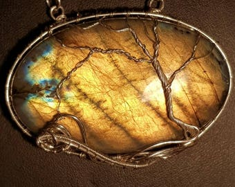 Labradorite with yellow, orange,blue, tree of life, wire wrapped in fine silver.