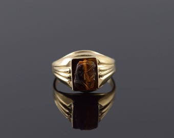 10k 9x7mm Soldier Carved Tigerseye Ring Gold