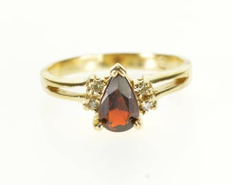 14k Garnet Pear Cut Diamond Accented Split Band Ring Gold