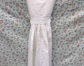 Vintage creamcoloured apron by Laura Ashley