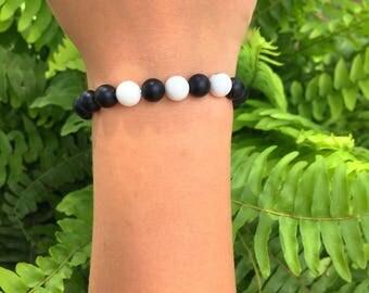 Black Bracelet with Three White Beads