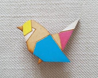 Origami bird with a blue wing Brooch